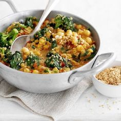 Chickpea, Tomato & Spinach Curry Recipe Main Dishes with onions, garlic cloves, ginger, tomatoes, oil, ground cumin, ground coriander, turmeric, chili flakes, yeast extract, red lentils, coconut cream, broccoli, chickpeas, baby spinach leaves, lemon, toasted sesame seeds, cashew nuts