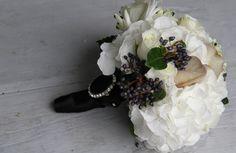 white hydrangeas, white roses, black berries, nerines, Arabicum Chincherinchee