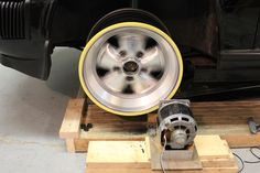 Wheel Spinner by theclaw -- Homemade wheel spinner consisting of an electric motor mounted to a wooden platform. Utilized to finish/polish rims while the wheels are attached to the car. http://www.homemadetools.net/homemade-wheel-spinner