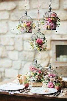 Brilliant. .mini birdcage ' s with little arrangements  sitting & hanging .. Great for a party.