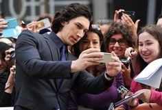 Actor Adam Driver poses with fans at the 'While We're Young' premiere during the Toronto International Film Festival in Toronto on Saturday, Sept. 6, 2014.  Photo by Evan Agostini of Invision.