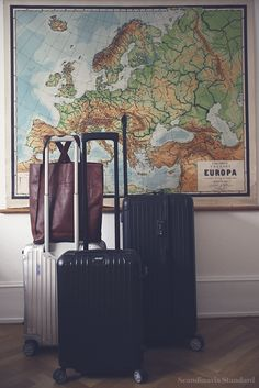 Could you possibly reduce your number of possessions to under 100? It's extremely difficult! Find out more about moving countries and living with less in Scandinavia. With Rimowa luggage and Armoire d'homme handbag.