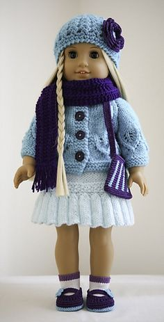 American Girl doll in blue sweater and cap