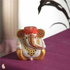 Gold Work Ganesh With Turban - Single piece white marble statute of Ganeshji that has been hand painted in bright orange and gilded with pure 22 carat gold leaf work and a cute turban to give a special look and studded with red, green and white kundans to add dazzle to the statue..   http://www.indiaplaza.com/gold-work-ganesh-with-turban-handicrafts-han15032012apr115-10.htm?utm_medium=social-media_campaign=Pinterest+daily+updates_source=Pinterest
