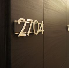 hotel metal signage on stone wall - Google Search
