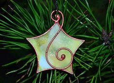 Stained glass star, Christmas tree decoration, stained glass ornament handmade with love. Stained glass star is made using the Tiffany method. Materials: glass, copper foil and wire. We make it in our small family home studio. This is an example. All stained glasses we make to order.