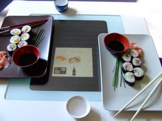 Multitouch interactive self service sushi table. Users can order things through a menu on the top. Glasses and plates may be put on top. http://www.simplemediaplatform.com