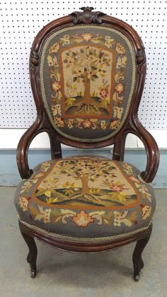 Victorian Civil War patriotic gent's parlor chair with needle point seat and back depicting birds in a tree -- carved black walnut frame with American shield at crest.