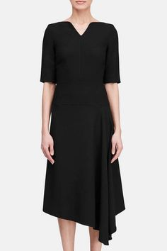 A master of structure and silhouette, Roland Mouret has an intuitive understanding of the female form. This viscose crepe dress follows his classic methods of construction. With a notched V-neck and elbow-length sleeves, it drapes to an asymmetric handkerchief hem. The back is finished with a polished gold zipper: a Mouret signature.