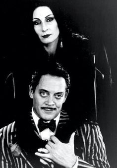 Morticia and Gomez Addams played by Anjelica Huston and Raul Julia in the movie version of The Addams Family The Addams Family, Los Addams, Morticia And Gomez Addams, Raul Julia, Vashta Nerada, Charles Addams, Anjelica Huston, The Munsters, Family Values