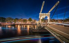 """Amstel Bridge Amsterdam - When we were in Amsterdam late August we took one of those sight seeing cruise ship tours like probably every tourist does. A friend of mine said I should take a picture of this famous bridge over the Amstel river. Well, unlike all the other tourists, I didn't take out my phone but I rather came back with tripod and camera at blue hour.  Thanks for your visit. If you like my images, stop by at <a href=""""http://www.hpd-fotografy.com"""">hpd-fotografy</a> or follow me on…"""