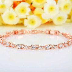 Rose Gold Bracelets & Sparkling Clear Cubic Zirconia CZ Crystal valentine's gift Material: gold plated clear cubic zirconia Length:7.48 Inches (19cm), width:0.4cm. Wearing Size 16 CM and 19 CM With top grade cubic zirconia inlaid, this bracelet turns an elegant and sparkling appearance, shining in every turn. Suitable for any occasion, easy to match the clothes, a good choice for you to wear every day. Popular in ladies, best gift to your love ones, she'll undoubtedly love this be...
