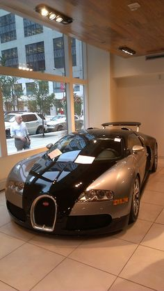 Bugatti Veyron...wonder what's going through this fellow's mind as he gazes through the window. Art, beauty, madness....