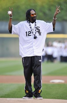 Pin for Later: Pitch Perfect — Stars Get Their Game On!  Snoop Lion threw up a peace sign before the first pitch at the Chicago White Sox game in May 2012.