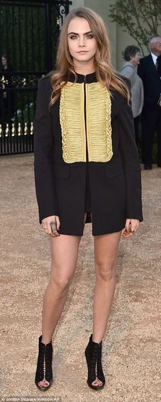 Legs for days: Cara Delevingne showcased a more androgynous style cloaking her upper body ...