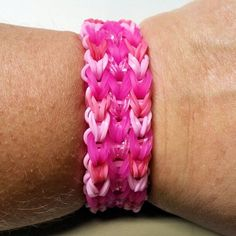 Three shades of pink bands and multi-color glitter bands make up this colorful handmade cuff bracelet. The glitter in the bands sparkles and shines in the light, making it stand out. All bands are latex-free.The bracelet is 1 in. wide and will fit a 5 to 8 in. wrist.