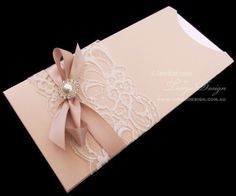 Lace & Sparkle Pocket Sleeve Invitation feature in rose gold or nude pink and white ribbon and bling. #blushweddinginvitation #blushandlaceinvitation #blushpinkinvitation #pearlandlaceinvitation