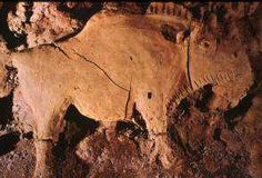 A Stone Age clay image of a bison modelled in high relief out of a great outcrop of clay in the Tuc d' Audoubert cavern in S.W. France. ca.15,000BC