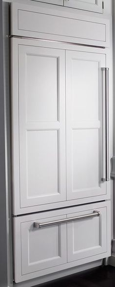 Oh to dream...I would LOVE a Sub-Zero Cabinet Enclosed Refrigerator--but in dark wood cabinet stain! :)
