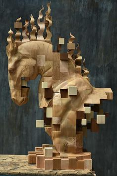 han hsu-tung crafts intricate pixelated sculptures made of wood