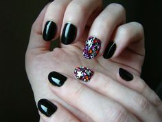 Blinged out accent by Red Hall using Essence Black is Back.