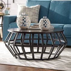 Anchor the parlor seating group with this chic coffee table, perfect for displaying a glowing array of candles or resting a tray of hot cocoa and treats for movie night. Living Room Green, Home Living Room, Living Room Decor, Round Wood Coffee Table, Modern Coffee Tables, Modern Table, Decoration Table, Table Centerpieces, Decoration Restaurant