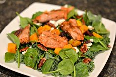 kale, spinach, toasted pecans, butternut squash, honey goat cheese and dried cranberries. Topped with salmon.