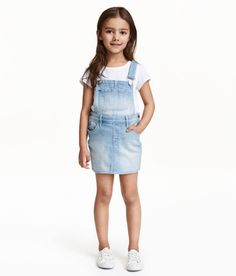 Check this out! Bib overall dress in washed stretch denim with adjustable suspenders. Bib pocket, side pockets, and back pockets. Buttons at sides. - Visit hm.com to see more.