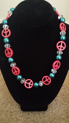 Teal and red peace sign necklace on Etsy, $15.00