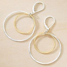 """These endless circles are a perennial customer favorite - bold and sexy but light as a feather! The larger sterling silver circle is approximately over 1"""" in diameter and the smaller gold filled ring"""
