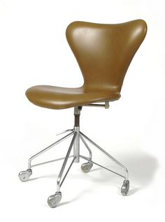 Arne Jacobsen; #3107 Leather, Steel and Laminated Wood Chair for Fritz Hansen, 1955.