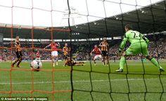 Power: Hull goalkeeper Stephen Harper can only watch as Podolski's shot hits the back of t...