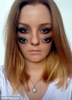 Mirror image: Belinda creates perfect replicas of her eyes on her cheeks...