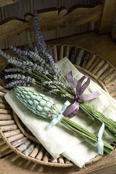 a lavender bottle woven with ribbon for the linen cupboard