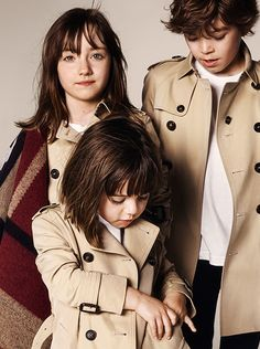The Burberry Childrenswear collection for Autumn/Winter 2014 - heritage trench coats and check blanket ponchos
