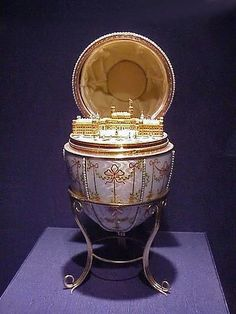 "34 (I) ""The Gatchina Palace"" egg was made for Nicholas II of Russia for his mother, the Dowager Empress Maria Feodorovna, on Easter 1901.  Crafted:  gold, enamel, silver-gilt, portrait diamonds, rock crystal, and seed pearls.  Surprise:  minature gold replica of the palace at Gatchina with statue of Paul I.  Work-Master:  Mikhail Perhin.  Location:  Walters Art Museum, Baltimore, Maryland, USA  (Wikipedia)"