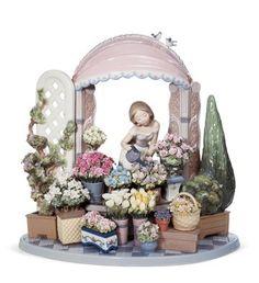 LLADRO - ROMANTIC FEELINGS  -  love the flowers, detail.  Lladro makes beautiful things, figurines, look!  want.      lj