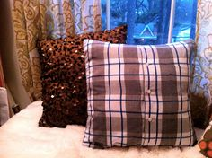 Pillow out of an old button up shirt. I am going to make a few of these out of papaw's old shirts.