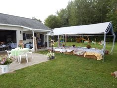 The canopy over the straw table and benches was piped with tulle and white lights!  Used large white buckets served as urns all around with wild flowers everywhere!
