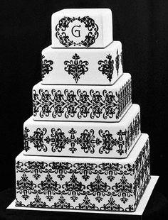 Formal black and white wedding cake with a monogram on the topmost tier #wedding #weddingcake #blacktie #cake #blackwhite
