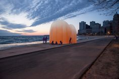 "Plastic Sunrise is constructed with often discarded colored high-density polyethylene, fused with stone as ""plastiglomerate""; the result is a pink and golden morning sky structure with a positive ecological impact. — Plastic Sunrise by  Meredith Miller and Thom Moran 
