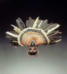 mask  Materials pitch, feather, resin, cotton, vegetal fibre, paper, textile  Place of collecting Democratic Republic of the Congo > Katanga > Lualaba  Culture Chokwe  Acquisition related person Gaston Fr. de Witte (°1897 - †1980), as donor  Date of acquisition 1931-12-21  Dimensions 71 cm x 90 cm x 28 cm