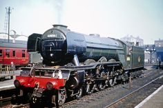 60056: Gresley A3 4-6-2 60056 'Centenary' at Kings Cross, August 1961. At this late stage, several of the class had been fitted with German-style smoke deflectors. Photo c/o Fotorus.