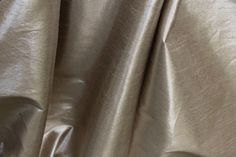 Description Named after the element gold on the periodic table, Atomic number 79 is faux dupioni fabric with a metallic.