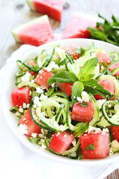 Cucumber Noodle, Watermelon, and Feta Salad Recipe on twopeasandtheirpod.com This cool and refreshing salad is easy to make and a great side for any summer meal.