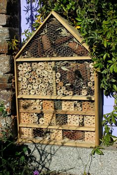 Large insect hotel using pallet wood planks and drilled pallet blocks.