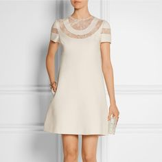 VALENTINO Lace-paneled wool and silk-blend crepe mini dress Shop now…