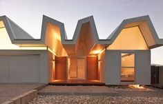 Now that's a crazy looking roof! Contemporary architecture and very innovative!