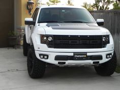 White Raptor with HRE's and Brembo's