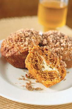 Pumpkin and Cream Cheese Muffins- Whether you have one after dinner or gobble it down in the A.M., these delicious bites are sure to satisfy any sweet tooth. Get more pumpkin dessert ideas at redbookmag.com and click through for the full recipe.